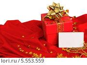Красный подарок с визитной карточкой. Стоковое фото, фотограф Pavel Kozlovsky / Фотобанк Лори