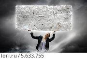 Купить «Непосильная ноша. Хрупкая девушка с огромным тяжелым камнем», фото № 5633755, снято 19 марта 2019 г. (c) Sergey Nivens / Фотобанк Лори