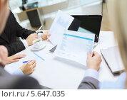 Купить «Деловое совещание в офисе», фото № 5647035, снято 9 ноября 2013 г. (c) Syda Productions / Фотобанк Лори