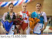 Три девушки призёры соревнований по гимнастике с наградами и цветами (2012 год). Редакционное фото, фотограф Losevsky Pavel / Фотобанк Лори