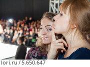 Купить «Две красивые девушки на показе мод», фото № 5650647, снято 21 марта 2012 г. (c) Losevsky Pavel / Фотобанк Лори