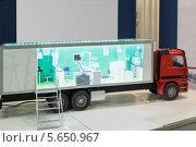 """Купить «Модель мобильной медицинской диагностической лаборатории на 20 Международной выставке """"Здравоохранение, медицинская техника и фармацевтика"""" 8 декабря 2010 года в Москве, Россия», фото № 5650967, снято 8 декабря 2010 г. (c) Losevsky Pavel / Фотобанк Лори"""