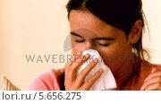 Купить «Sick girl sneezing», видеоролик № 5656275, снято 16 февраля 2019 г. (c) Wavebreak Media / Фотобанк Лори