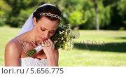 Купить «Upset bride sitting on the grass», видеоролик № 5656775, снято 16 февраля 2019 г. (c) Wavebreak Media / Фотобанк Лори