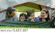 Купить «Happy family on a camping trip in their tent», видеоролик № 5657307, снято 22 июля 2019 г. (c) Wavebreak Media / Фотобанк Лори