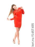 Купить «Привлекательная светловолосая девушка в красном платье», фото № 5657655, снято 24 ноября 2013 г. (c) Сергей Сухоруков / Фотобанк Лори
