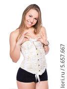 Купить «Портрет девушки в корсете на белом фоне», фото № 5657667, снято 24 ноября 2013 г. (c) Сергей Сухоруков / Фотобанк Лори