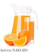 Купить «Апельсины, кувшин и стакан цитрусового сока на белом фоне», фото № 5661651, снято 23 апреля 2012 г. (c) Natalja Stotika / Фотобанк Лори