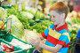 Мальчик выбирает капусту в супермаркете, фото № 5680159, снято 10 июня 2013 г. (c) Дмитрий Калиновский / Фотобанк Лори