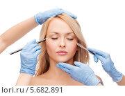 Купить «Испуганная девушка и руки пластических хирургов», фото № 5682891, снято 7 января 2014 г. (c) Syda Productions / Фотобанк Лори