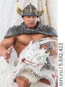 Купить «Мускулистый мужчина в костюме викинга с головой дракона», фото № 5692423, снято 3 октября 2013 г. (c) Losevsky Pavel / Фотобанк Лори
