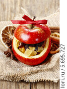 Купить «Красное яблоко, наполненное сухофруктами», фото № 5695727, снято 24 апреля 2019 г. (c) BE&W Photo / Фотобанк Лори