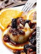 Купить «Маринованная сельдь с сухофруктами и сливовым соусом», фото № 5702659, снято 19 февраля 2019 г. (c) BE&W Photo / Фотобанк Лори
