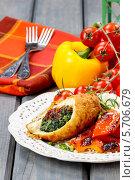 Купить «Ролл с курицей и овощами на тарелке на деревянном столе», фото № 5706679, снято 20 июля 2018 г. (c) BE&W Photo / Фотобанк Лори