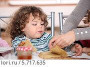 Купить «ребенка кормят блинами», фото № 5717635, снято 20 октября 2010 г. (c) Phovoir Images / Фотобанк Лори