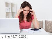 Купить «уставшая женщина делает подсчеты», фото № 5740263, снято 20 октября 2013 г. (c) Андрей Попов / Фотобанк Лори