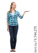 Купить «Привлекательная девушка в повседневной одежде согнула руку в локте, изолированно на белом», фото № 5744275, снято 12 февраля 2014 г. (c) Syda Productions / Фотобанк Лори