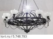 Купить «Старинная черная люстра», фото № 5748783, снято 12 апреля 2013 г. (c) Losevsky Pavel / Фотобанк Лори