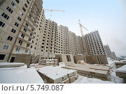 Купить «Строительство домов зимой», фото № 5749087, снято 10 декабря 2012 г. (c) Losevsky Pavel / Фотобанк Лори