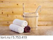 Купить «Традиционная деревянная сауна с ведром воды и набором чистых полотенец», фото № 5753419, снято 2 марта 2014 г. (c) Lora Liu / Фотобанк Лори