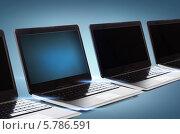 Купить «Ряд компьютеров с черными экранами», фото № 5786591, снято 14 ноября 2013 г. (c) Syda Productions / Фотобанк Лори