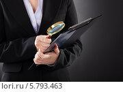 Купить «деловая женщина изучает документ с лупой», фото № 5793463, снято 5 января 2014 г. (c) Андрей Попов / Фотобанк Лори