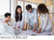 Купить «Casual architecture team working together at desk», фото № 5806223, снято 24 января 2020 г. (c) Wavebreak Media / Фотобанк Лори