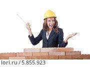 Купить «Счастливая женщина-строитель с рулеткой», фото № 5855923, снято 27 июля 2012 г. (c) Elnur / Фотобанк Лори
