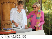 Купить «молодая женщина помогает пожилой маме погладить одежду», фото № 5875163, снято 26 октября 2010 г. (c) Phovoir Images / Фотобанк Лори