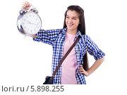Купить «Студентка с будильником в руке. Девушка держит в руке часы и смотрит на них», фото № 5898255, снято 26 апреля 2013 г. (c) Elnur / Фотобанк Лори