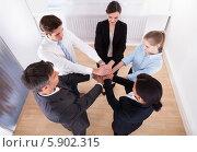 Купить «сотрудники компании сложили руки вместе», фото № 5902315, снято 15 декабря 2013 г. (c) Андрей Попов / Фотобанк Лори