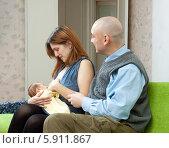 Купить «Женщина кормит грудью младенца», фото № 5911867, снято 23 ноября 2012 г. (c) Яков Филимонов / Фотобанк Лори