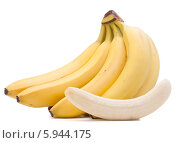 Купить «Очищенный банан на фоне неочищенных», фото № 5944175, снято 22 марта 2013 г. (c) Natalja Stotika / Фотобанк Лори