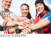 Купить «Друзья-тинейджеры сложили руки вместе», фото № 5954959, снято 20 июля 2013 г. (c) Syda Productions / Фотобанк Лори