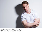 Купить «Portrait of attractive smiling man in white t-shirt.», фото № 5962027, снято 26 февраля 2014 г. (c) Валуа Виталий / Фотобанк Лори