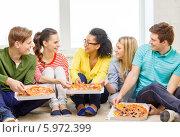 Купить «Друзья разговаривают и едят пиццу, сидя на полу дома», фото № 5972399, снято 29 марта 2014 г. (c) Syda Productions / Фотобанк Лори