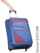 Купить «Рука держит дорожный чемодан за ручку», фото № 6017599, снято 28 мая 2012 г. (c) Elnur / Фотобанк Лори