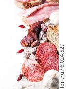 Купить «Мясное ассорти, перец чили и хлеб. Место для текста», фото № 6024527, снято 22 февраля 2014 г. (c) Natasha Breen / Фотобанк Лори