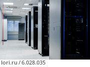 Купить «Оборудование в серверной комнате дата-центра», фото № 6028035, снято 14 мая 2014 г. (c) Alexander Tihonovs / Фотобанк Лори
