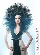 Black peacock woman in dress. Стоковое фото, фотограф Александр Буц / Фотобанк Лори