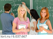 Two smiling student girls in math class. Стоковое фото, фотограф CandyBox Images / Фотобанк Лори