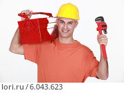 Craftsman carrying toolbox. Стоковое фото, фотограф Phovoir Images / Фотобанк Лори
