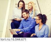 Купить «team with tablet pc computer sitting on staircase», фото № 6044671, снято 1 февраля 2014 г. (c) Syda Productions / Фотобанк Лори