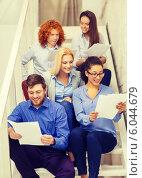 Купить «team with papers and take away coffee on staircase», фото № 6044679, снято 1 февраля 2014 г. (c) Syda Productions / Фотобанк Лори