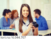 Купить «smiling female photographer with photocamera», фото № 6044707, снято 1 февраля 2014 г. (c) Syda Productions / Фотобанк Лори