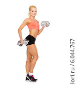 Купить «smiling sporty woman with heavy steel dumbbells», фото № 6044767, снято 8 мая 2014 г. (c) Syda Productions / Фотобанк Лори