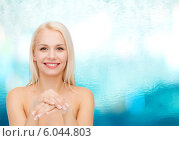 Купить «face and hands of beautiful woman», фото № 6044803, снято 15 апреля 2014 г. (c) Syda Productions / Фотобанк Лори