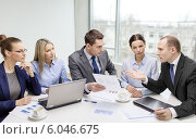 Купить «business team with laptop having discussion», фото № 6046675, снято 9 ноября 2013 г. (c) Syda Productions / Фотобанк Лори