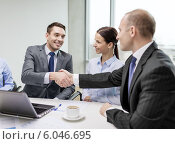 Купить «two businessman shaking hands in office», фото № 6046695, снято 9 ноября 2013 г. (c) Syda Productions / Фотобанк Лори
