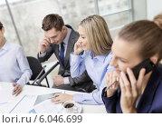 Купить «business team with smartphones having conversation», фото № 6046699, снято 9 ноября 2013 г. (c) Syda Productions / Фотобанк Лори